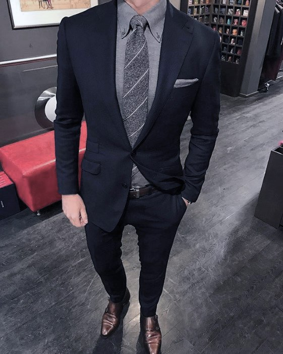 navy blue suit with grey shirt